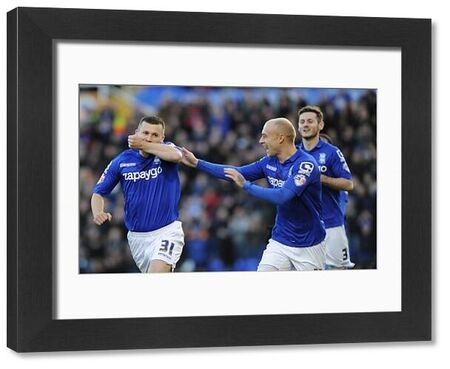 Birmingham City's Paul Caddis celebrates his goal with team-mate David Cotterill (right)