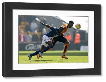 Birmingham's Jacques Maghoma and Wolves' Kortney Hause (right) battle for the ball during the Sky Bet Championship match at Molineux, Wolverhampton