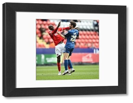 Charlton Athletic's Alou Diarra (left) and Birmingham City's Jon Toral clash. Both players receive treatment and Toral eventually leaves the game injured after scoring the first goal