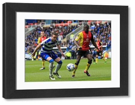 Birmingham City's Clayton Donaldson (right) and Reading's Chris Gunter battle for the ball