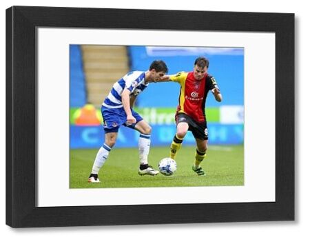 Birmingham City's Stephen Gleeson (right) and Reading's Lucas Piazon battle for the ball