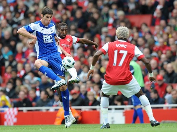Birmingham City's Nikola Zigic (left) and Arsenal's Johan Djourou (centre) battle for the ball