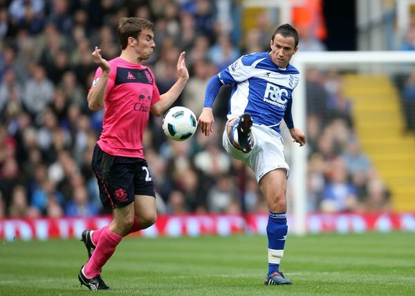 Birmingham City's Keith Fahey (right) and Everton's Seamus Coleman battle for the ball
