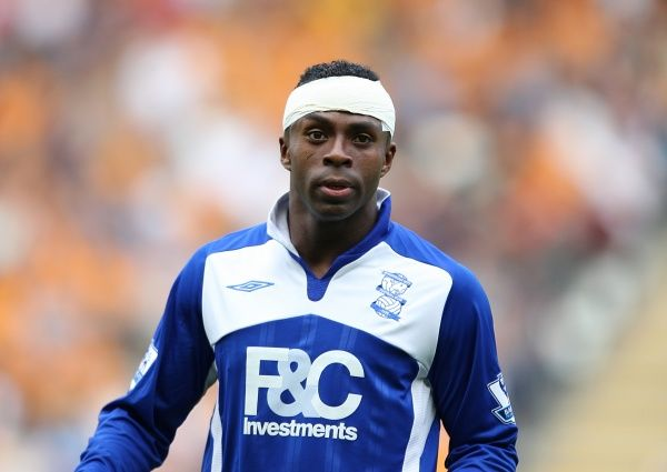 Birmingham City's Christian Benitez sports a bandage after receiving a head wound