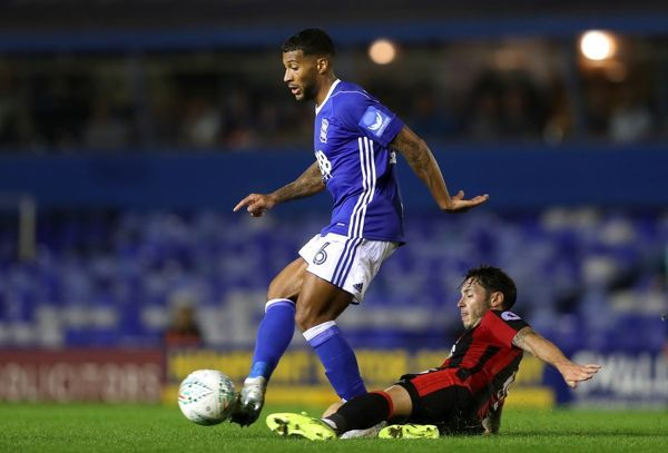 Birmingham City's Maikel Kieftenbeld (left) and AFC Bournemouth's Adam Smith battle for the ball during the Carabao Cup, Second Round match at St Andrew's, Birmingham