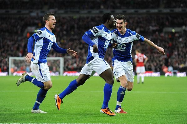 Birmingham City's Obafemi Martins (centre) celebrates wildly with team-mates Liam Ridgewell and Barry Ferguson (left) after scoring their second goal of the game