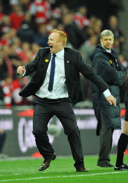 Birmingham City manager Alex McLeish celebrates at the final whistle during the Carling Cup Final at Wembley Stadium, London