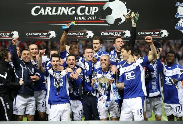 Birmingham City's Stephen Carr (number 2) and his team-mates celebrate their victory with the trophy