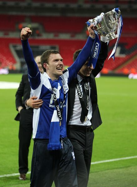 Birmingham City's Craig Gardner celebrates with the trophy