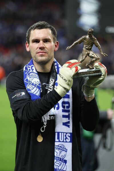 Birmingham City goalkeeper Ben Foster celebrates with his man of the match trophy