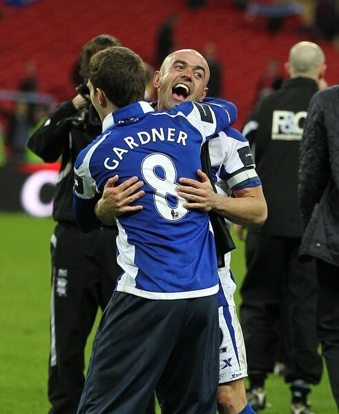 Birmingham City's Craig Gardner and Stephen Carr celebrate after the game