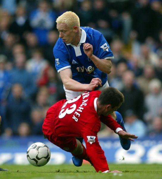 Birmingham City's Mikael Forssell clashes with Liverpool's Jamie Carragher