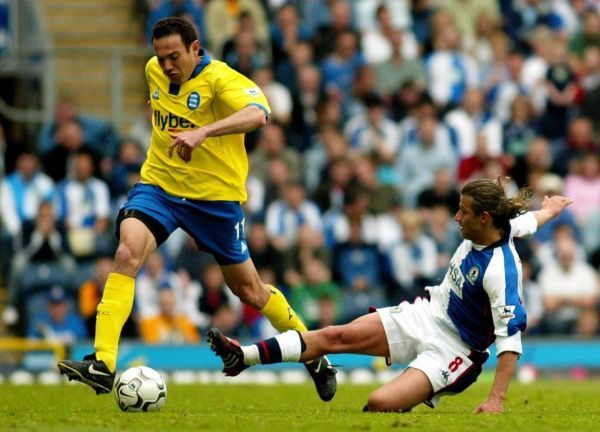 Blackburn Rovers' Tugay (right) slides in to tackle Stan Lazaridis of Birmingham City, during their Barclaycard Premiership match at Blackburn's Ewood Park