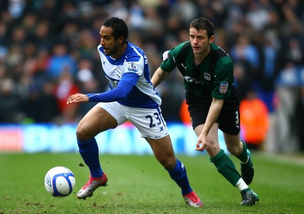 Birmingham City's Jean Beausejour (left) breaks away from Coventry City's Stephen O'Halloran (right)