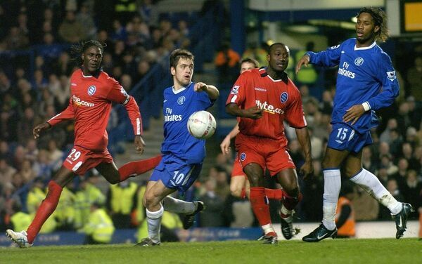 Chelsea's Didier Drogba (R) tussles for the ball with Birmingham City's Olivier Tebily (second right) and Mario Melchiot (L) as Joe Cole looks