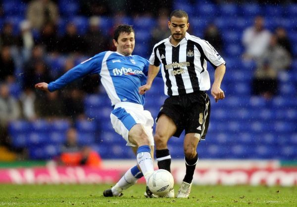 Newcastle United's Kieron Dyer (right) and Birmingham's Damien Johnson tussle