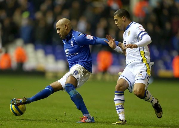 Birmingham City's Marlon King (left) and Leeds United's Lee Peltier (right) battle for the ball