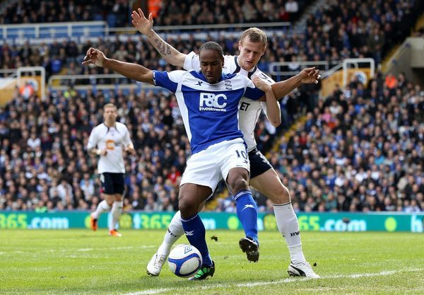 Birmingham City's Cameron Jerome (left) and Bolton Wanderers' David Wheater (right) battle for the ball