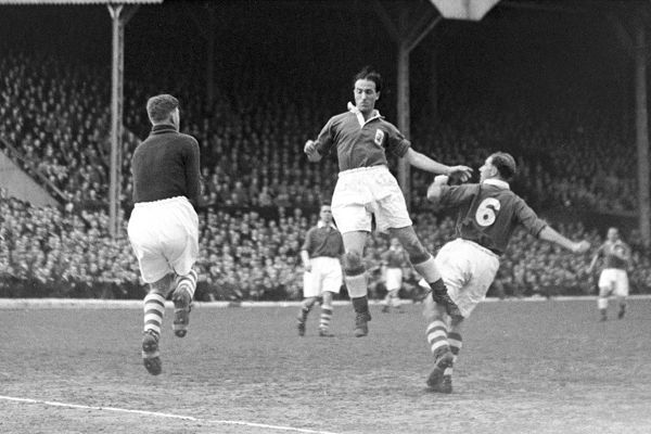 (L-R) Charlton Athletic goalkeeper Sam Bartram fields a long ball as Birmingham City's John Jordan narrowly fails to connect with a header