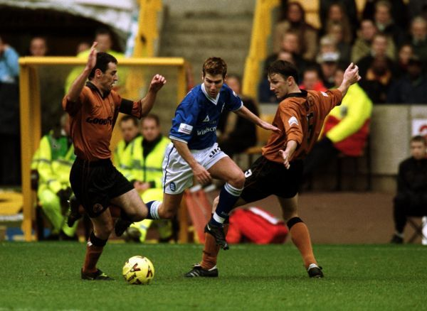 Birmingham City's Mark Burchill (c) gets between Wolverhampton Wanderers' Kevin Muscat (l) and Ludovic Pollet (r)