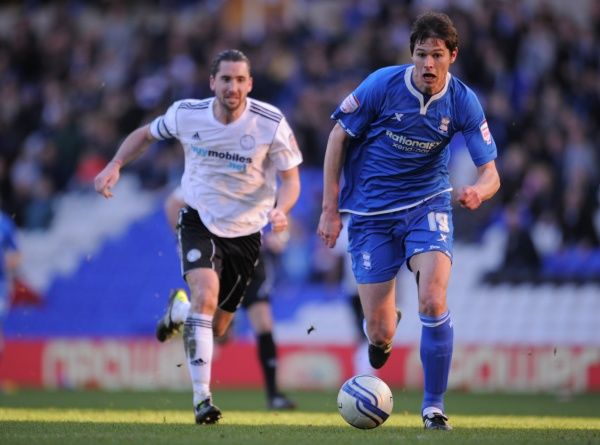 Birmingham City's Nikola Zigic and Derby County's Shaun Barker