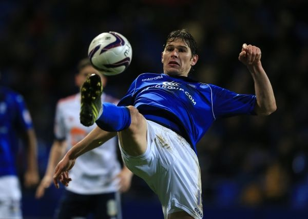 Birmingham City's Nikola Zigic lunges for the ball