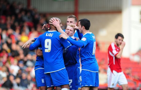 Birmingham City's Chris Burke (centre) celebrates his goal to make it 1-0 against Bristol City