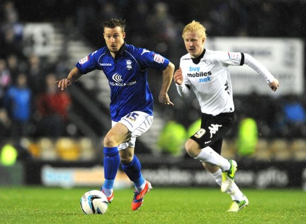 Derby County's Will Hughes (right) and Birmingham City's Wade Elliott (left)