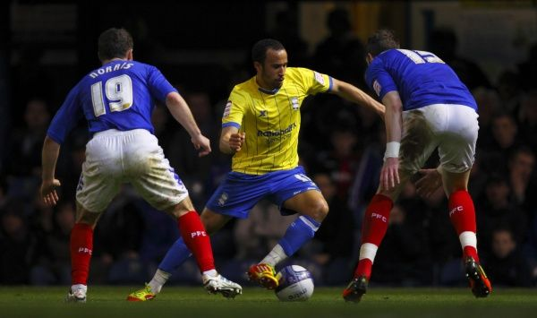 Birmingham's Andros Townsend in action against Portsmouth's Nikola Zigic (left) and Greg Halford during the npower Championship match at Fratton Park, Portsmouth