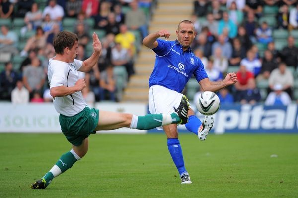 Birmingham City's David Murray passes the ball as Plymouth Argyle's Luke Young comes in to tackle during the Pre-Season Friendly at Holme Park, Plymouth