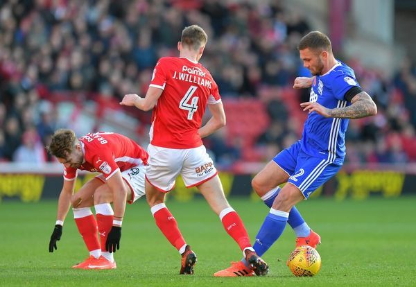 Birmingham City's Harlee Dean (right) battles with Barnsley's Joe Williams