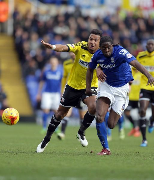 Birmingham City's Clayton Donaldson (Right) and Brentford's Liam Moore battle for the ball