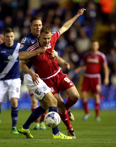 Middlesbrough's Jordan Rhodes (front) and Birmingham City's Michael Morrison battle for the ball during the Sky Bet Championship match at St Andrew's, Birmingham. PRESS ASSOCIATION Photo. Picture date: Friday April 29, 2016. See PA story SOCCER Birmingham