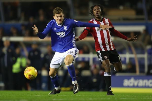 Birmingham City's Sam Gallagher and Brentford's Romaine Sawyers (right)