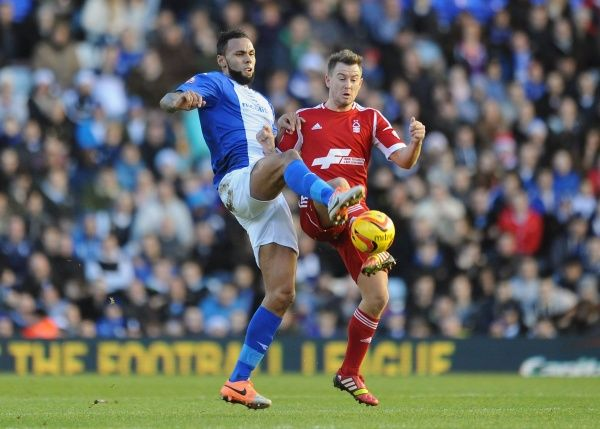 Birmingham City's Kyle Bartley (left) and Nottingham Forest's Simon Cox (right) battle for the ball during the Sky Bet Championship match at St. Andrew's, Birmingham