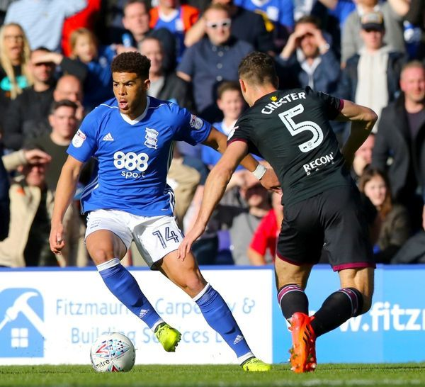 Birmingham City's Che Adams (left) and Aston Villa's James Chester battle for the ball during the Sky Bet Championship match at St Andrew's, Birmingham