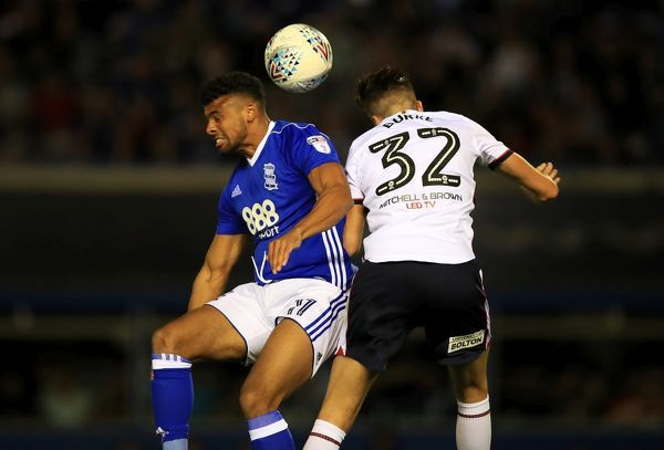 Birmingham City's Isaac Vassell (left) and Bolton Wanderers' Reece Burke battle for the ball