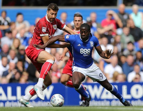 Birmingham City's Clayton Donaldson and Bristol City's Jens Hegeler (right) battle for the ball