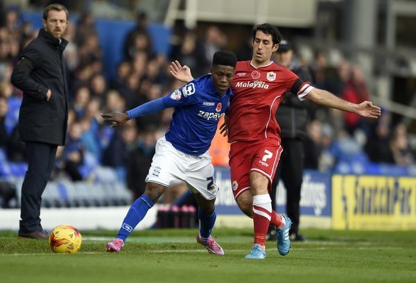 Birmingham City's Koby Arthur (Left) is tackled by Cardiff City's Peter Whittingham