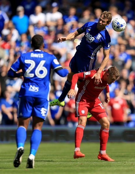 Birmingham City's Michael Morrison heads away from Cardiff City's Anthony Pilkington