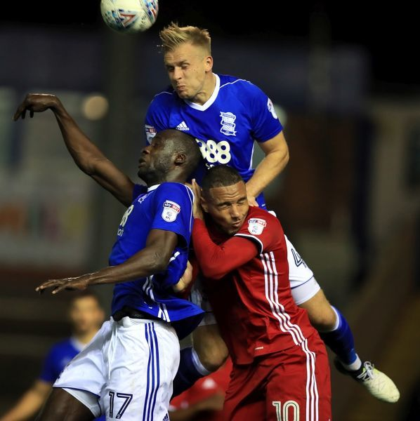 Birmingham City's Cheikh Ndoye and Michael Morrison and Cardiff City's Kenneth Zohore
