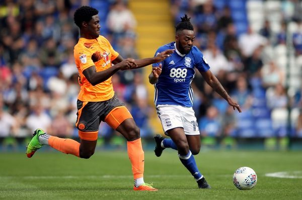 Birmingham City's Jacques Maghoma (right) and Reading's Tyler Blackett battle for the ball