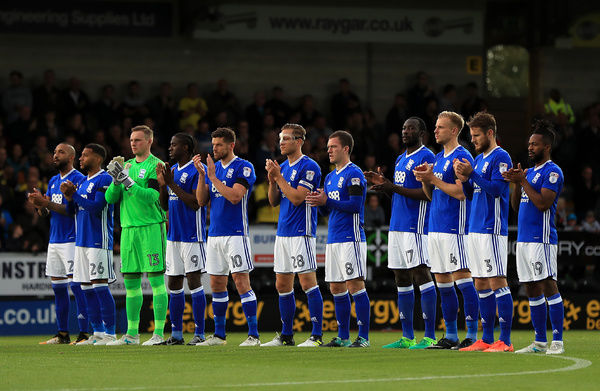 Birmingham City players during a minute's applause in tribute to the victims of yesterday's terror attack in Barcelona before the Sky Bet Championship match at the Pirelli Stadium, Burton