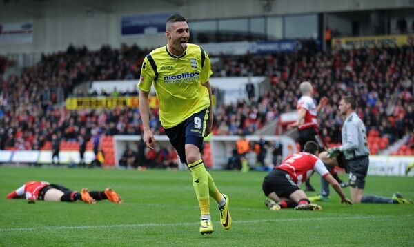 Birmingham City's Federico Macheda celebrates after scoring his sides opening goal of the game against Doncaster Rovers