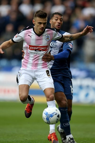 Huddersfield Town's Jamie Paterson and Birmingham City's David Davis (right) in action