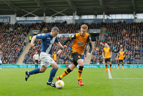 Birmingham City's Paul Caddis takes on Hull City's Sam Clucas