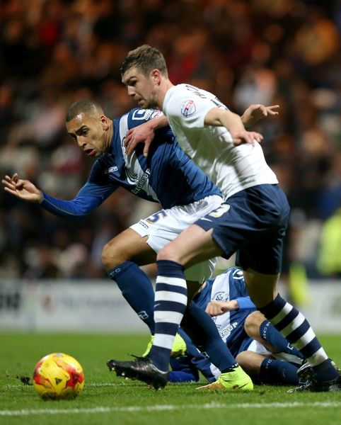 Birmingham City's James Vaughan battles for the ball with Preston North End's Paul Huntington, during the Sky Bet Championship match at Deepdale, Preston