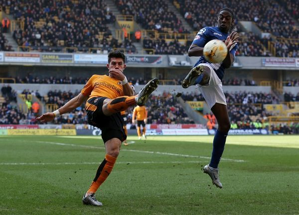 Birmingham's Clayton Donaldson and Wolves' Danny Batth (left) battle for the ball during the Sky Bet Championship match at Molineux, Wolverhampton