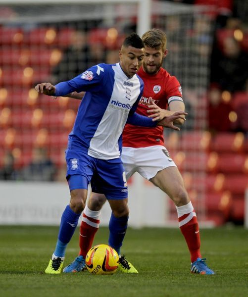 Barnsley's Martin Cranie and Birmingham City's Jesse Lingard battle for the ball